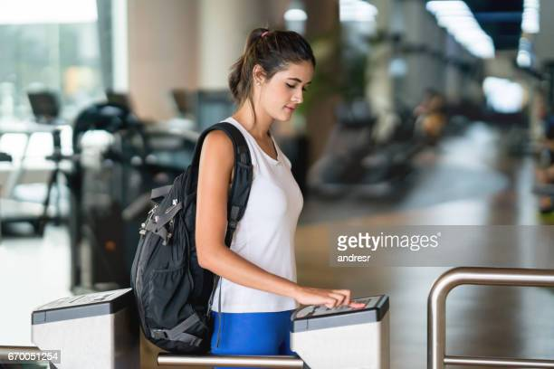 woman getting a fingerprint scan to access the gym - biometrics stock photos and pictures