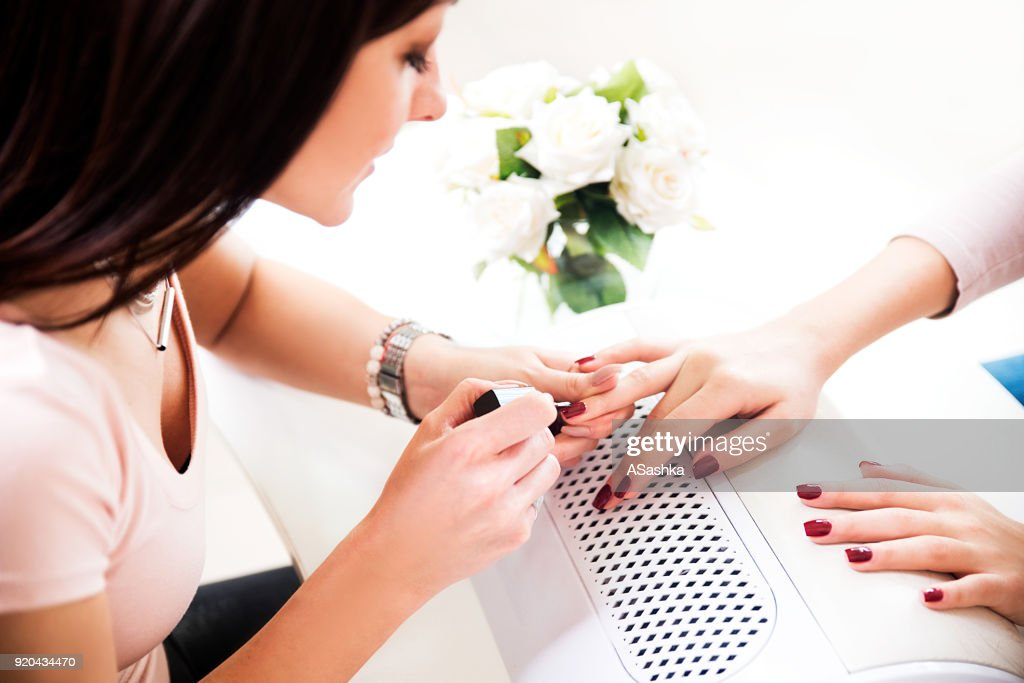 Woman getting a manicure : Stock Photo