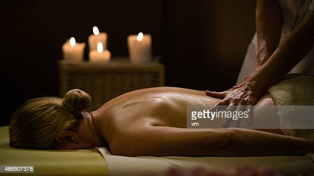 woman getting a massage in a romantic environment - sensual massage stock photos and pictures