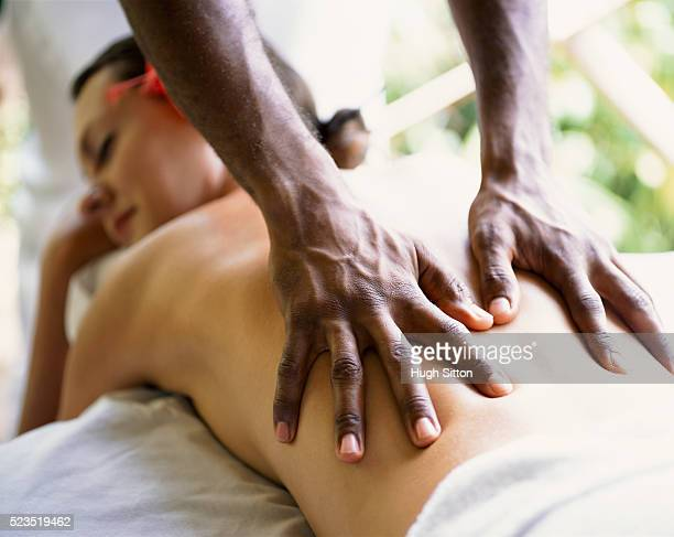 woman getting a massage - hugh sitton stockfoto's en -beelden