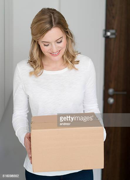 Woman getting a package at home