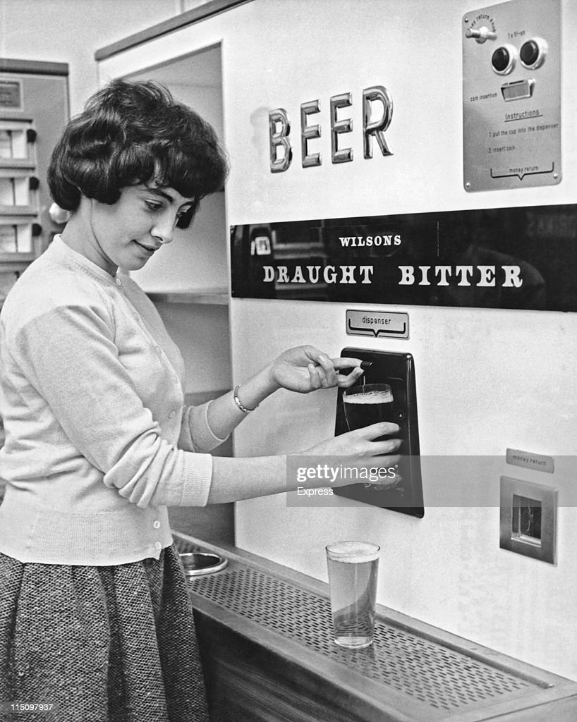 A woman getting a pint of draught bitter from a vending machine circa 1960's.