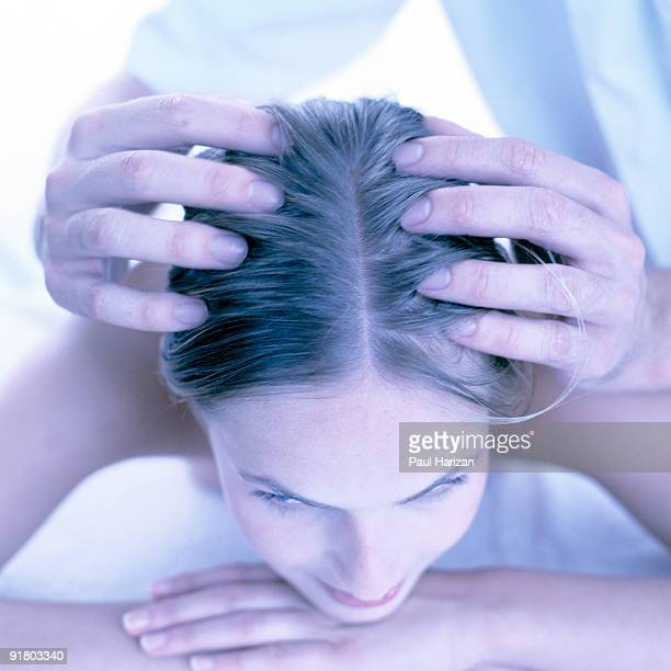 Woman getting a scalp massage