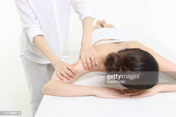 woman getting arm massage - body massage japan stock pictures, royalty-free photos & images