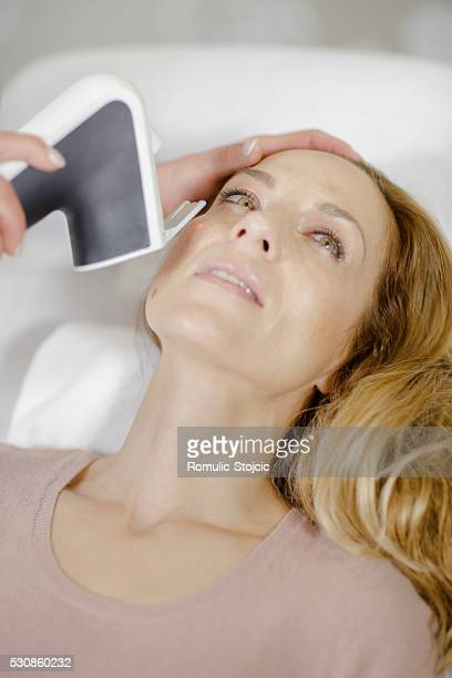 Woman getting beauty treatment, close-up