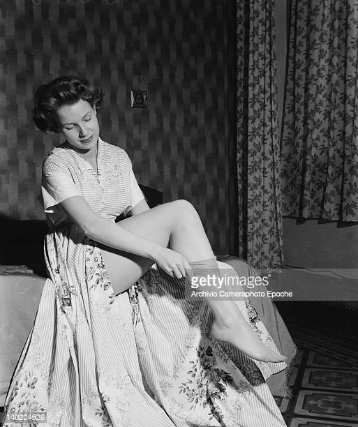 A woman getting dressed in Milan 25th October 1949 This photograph is either of or by photographer Sigrid von Schweinitz aka Sisi