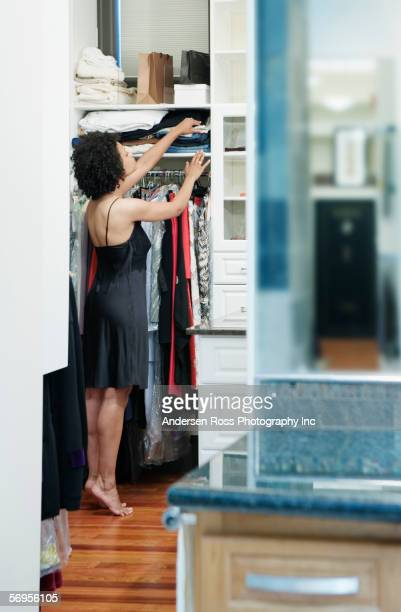 woman getting dressed - walk in closet stock photos and pictures