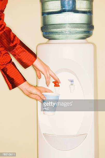 Woman getting drink from water cooler