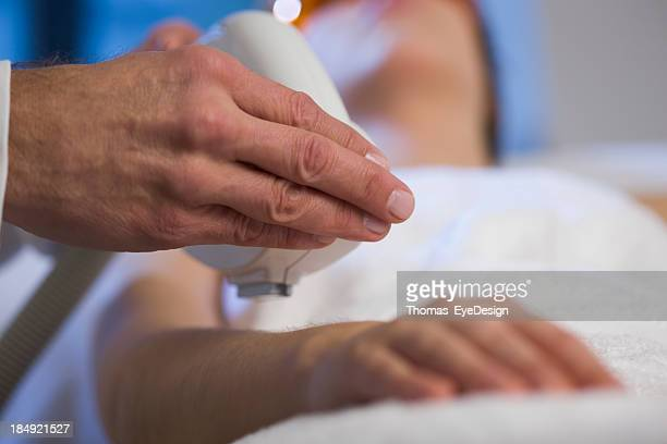 Woman getting Electrolysis Treatment on her upper Arm
