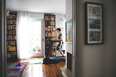 Woman getting fit and doing home training in the living room