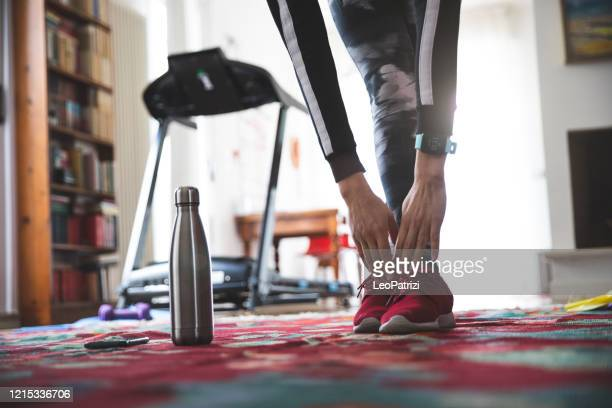 woman getting fit and doing home training in the living room - reusable stock pictures, royalty-free photos & images