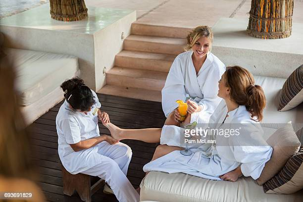 Woman getting foot massages at resort in Mexico