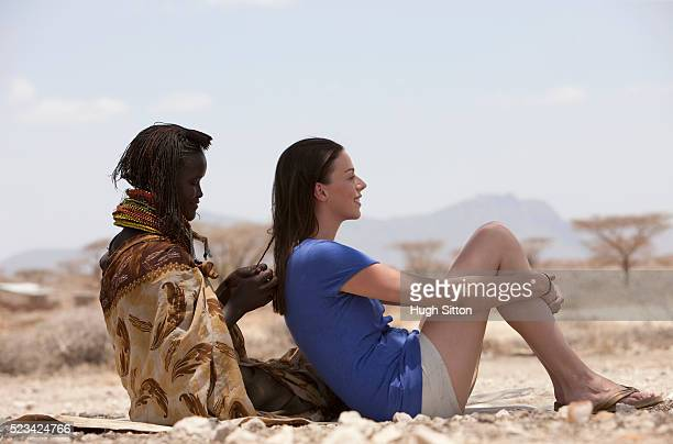 woman getting hair braided - hugh sitton stock pictures, royalty-free photos & images