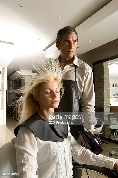 Woman getting hair dried