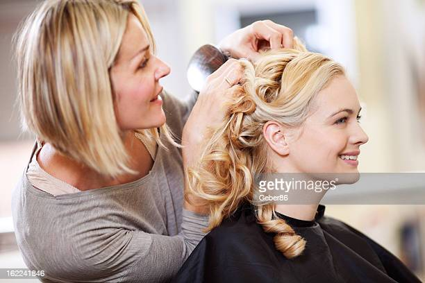 Woman getting hairstyle