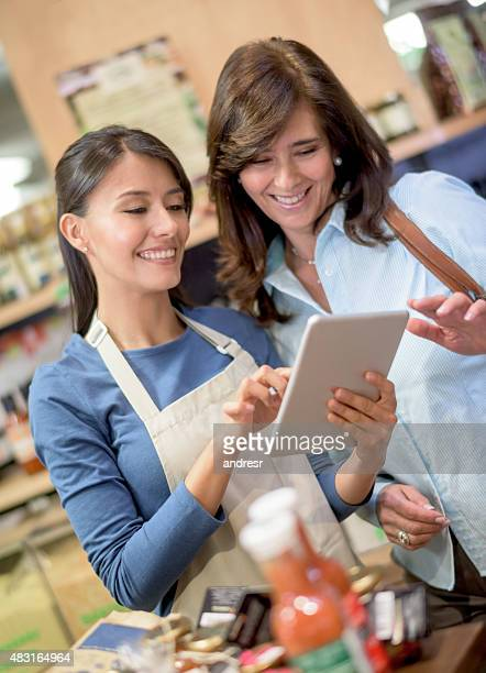Woman getting help at the supermarket