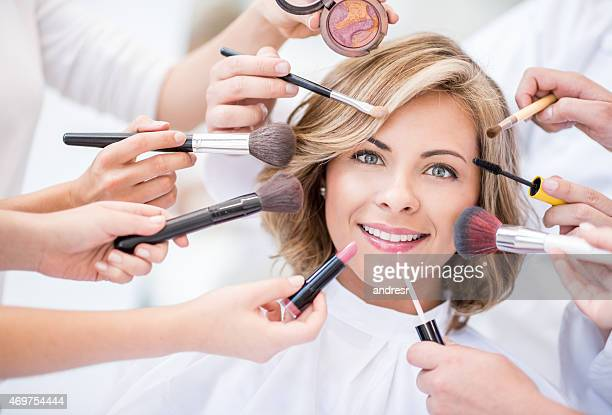 Woman getting her make up done