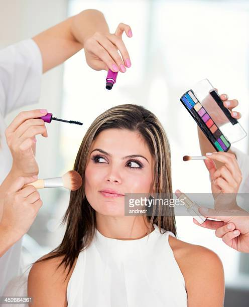 Woman getting her make-up done