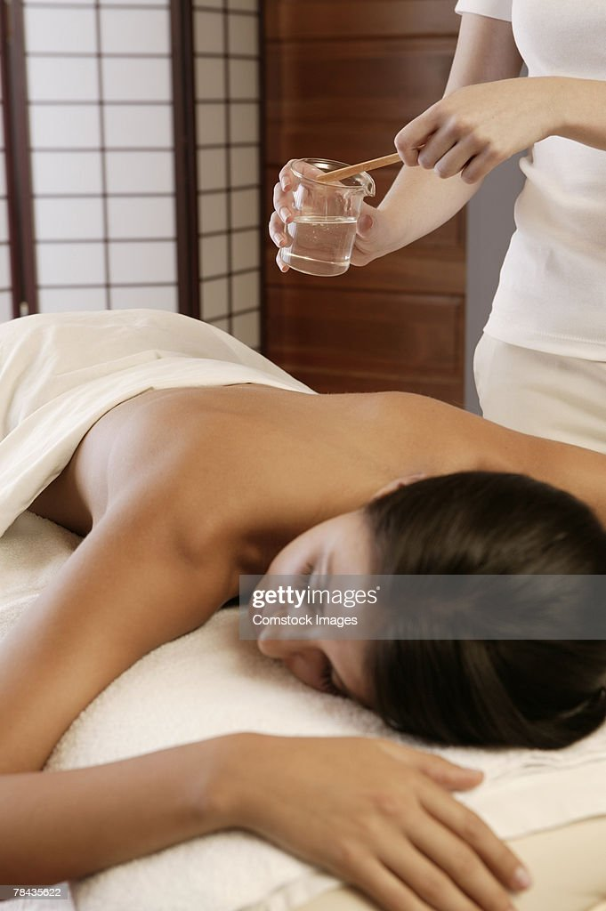 Woman getting hot oil massage : Stock Photo