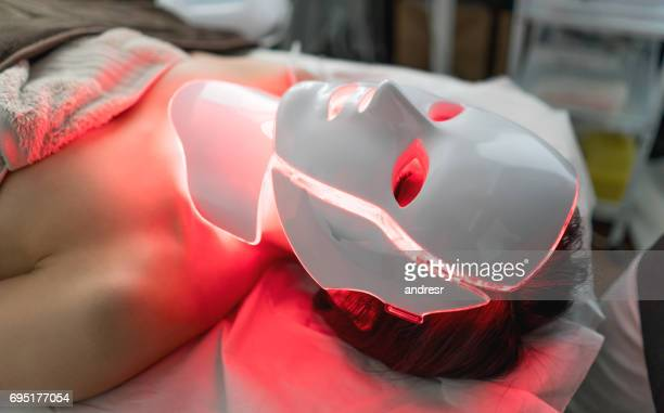 woman getting laser treatment at the spa - beauty care occupation stock photos and pictures