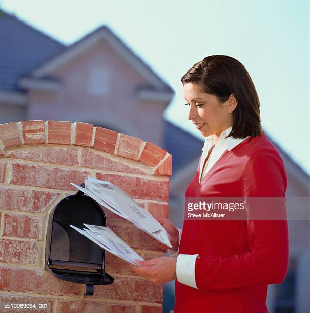 Woman getting mail from mailbox