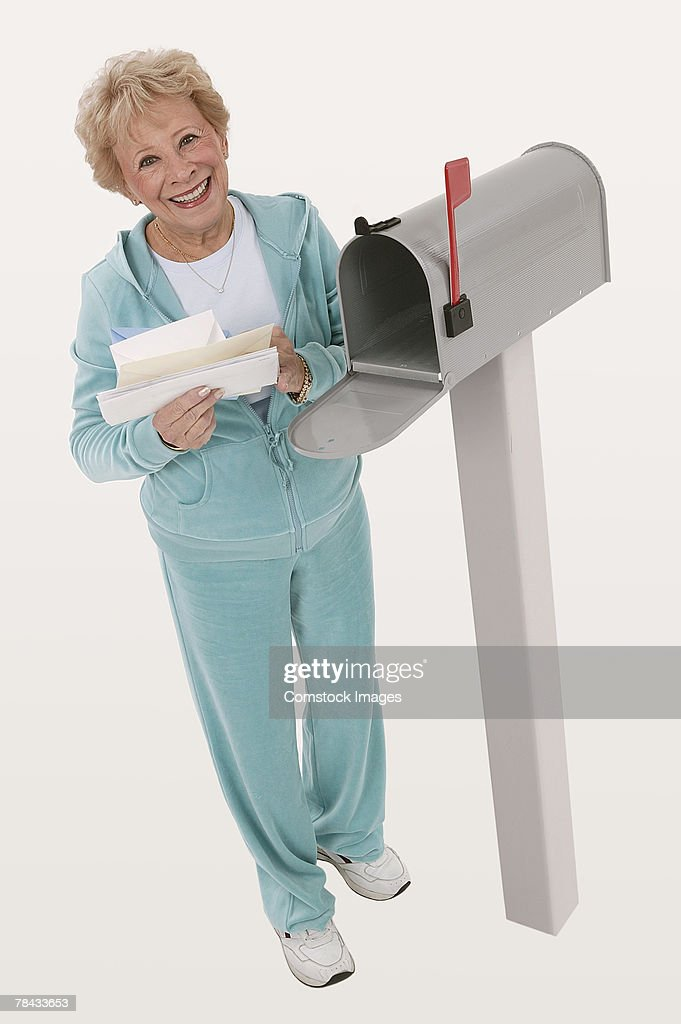 Woman getting mail : Stock Photo