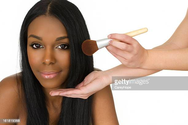 woman getting make over