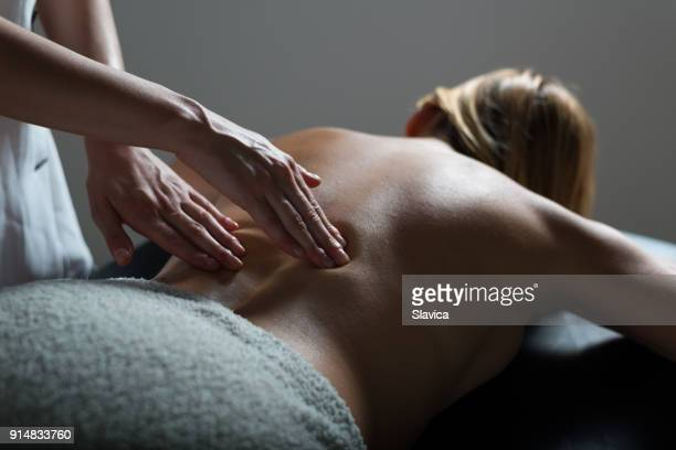 woman getting massage in health spa - massaggi foto e immagini stock