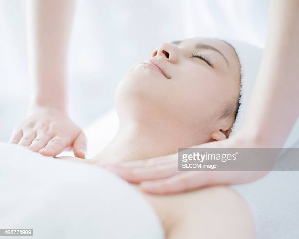 woman getting massage treatment - massaggio sensuale foto e immagini stock