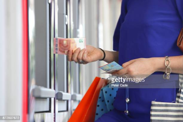 Woman getting money from cash point
