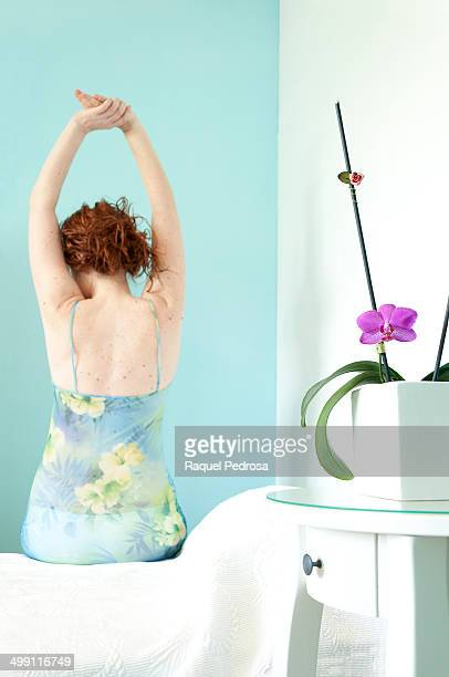 Woman getting out of bed in the morning