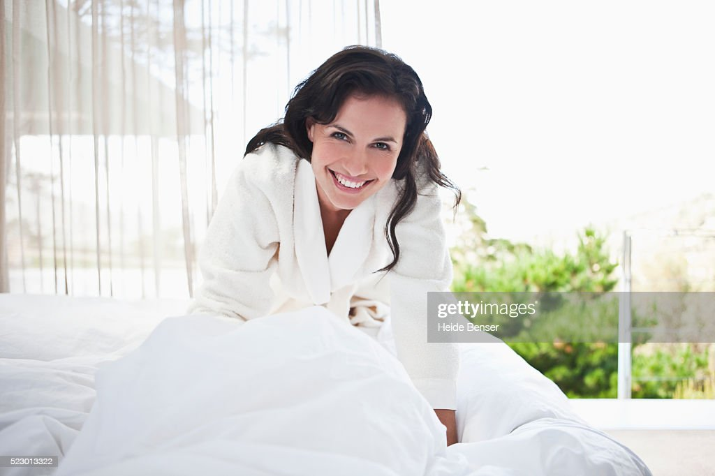 Woman getting out of bed : Stock Photo