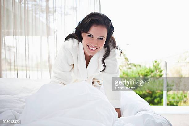 Woman getting out of bed