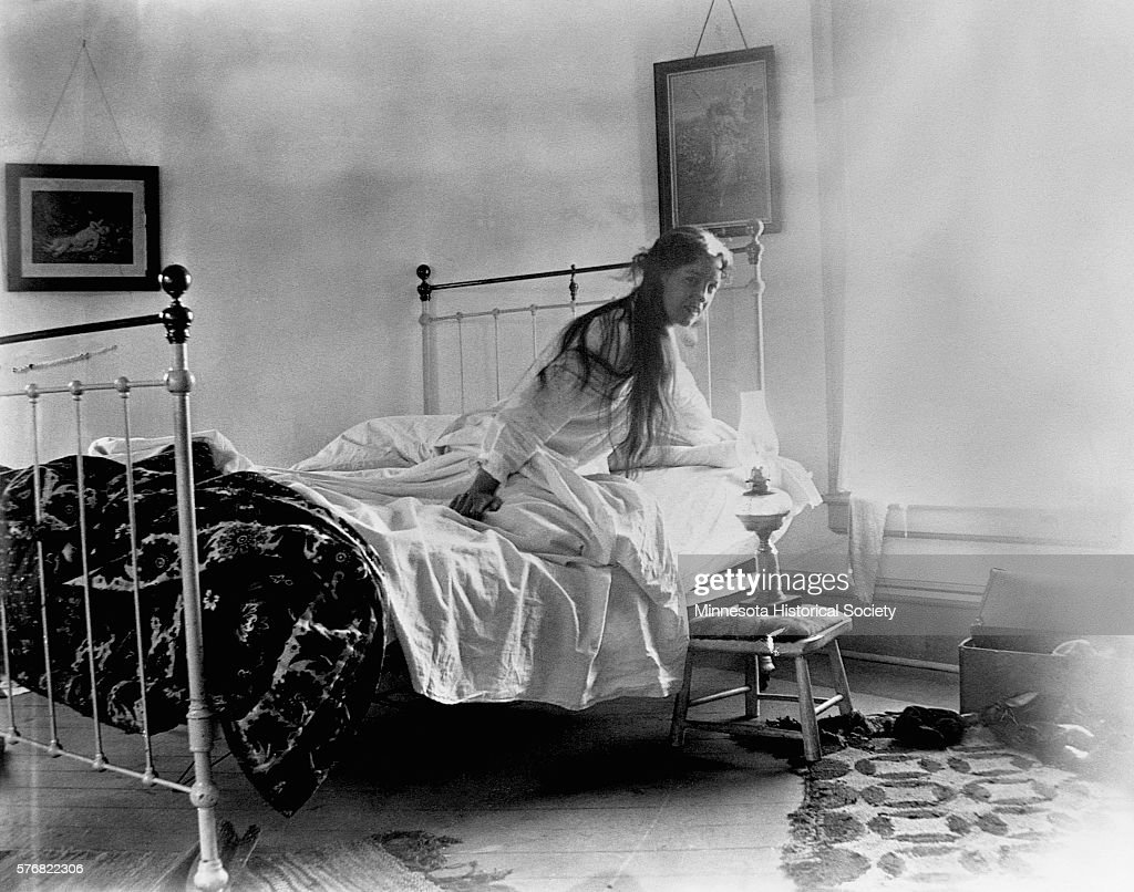 Woman Getting out of Bed : News Photo