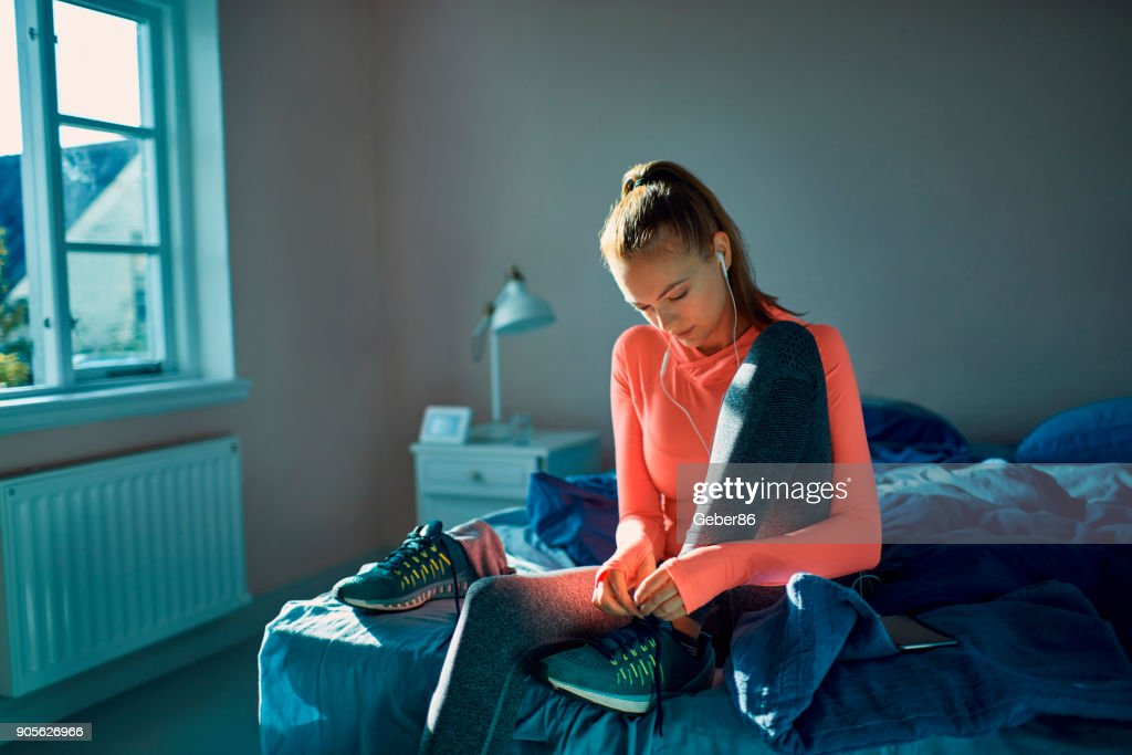 Woman getting ready for a workout : Stock Photo