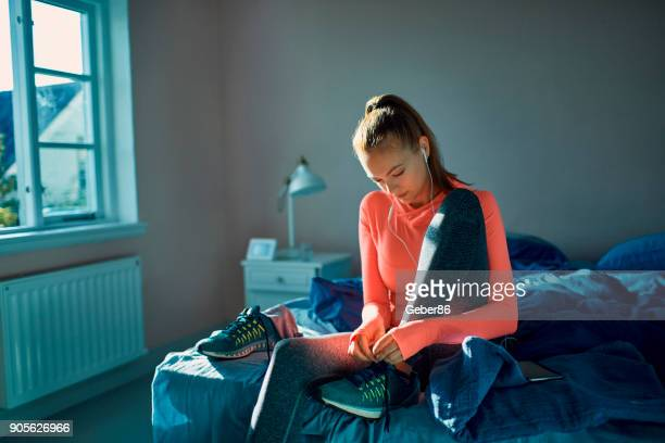 woman getting ready for a workout - waking up stock pictures, royalty-free photos & images