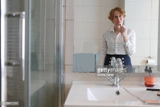woman getting ready for work - caucasian appearance stock pictures, royalty-free photos & images