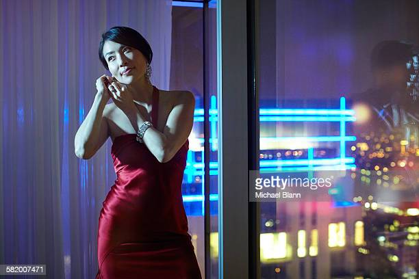 woman getting ready to go out at night - jewellery stock pictures, royalty-free photos & images