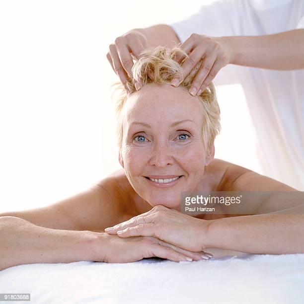 Woman getting scalp massage
