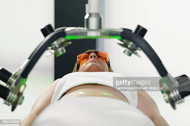 Woman getting soft laser treatment