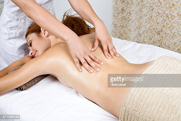 woman getting spa treatment - sensual massage stock photos and pictures