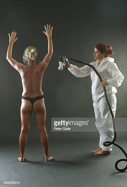 Woman getting spray tan