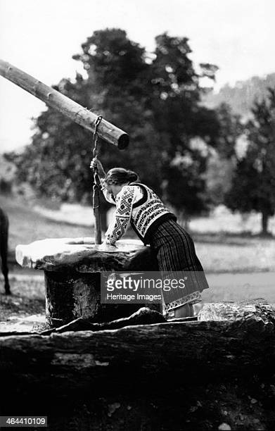 Woman getting water from a well Bistrita Valley Moldavia northeast Romania c1920c1945 Depicting customs and traditional labour in the rural...