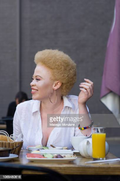 gorgeous woman having breakfast in the city - thick black woman stock photos and pictures