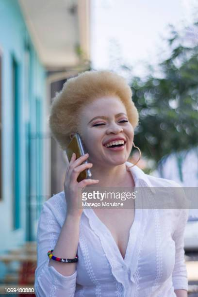woman using a cellphone in the city - thick black woman stock photos and pictures
