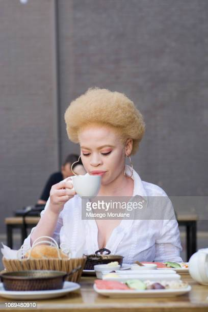 gorgeous woman sipping tea - thick black woman stock photos and pictures