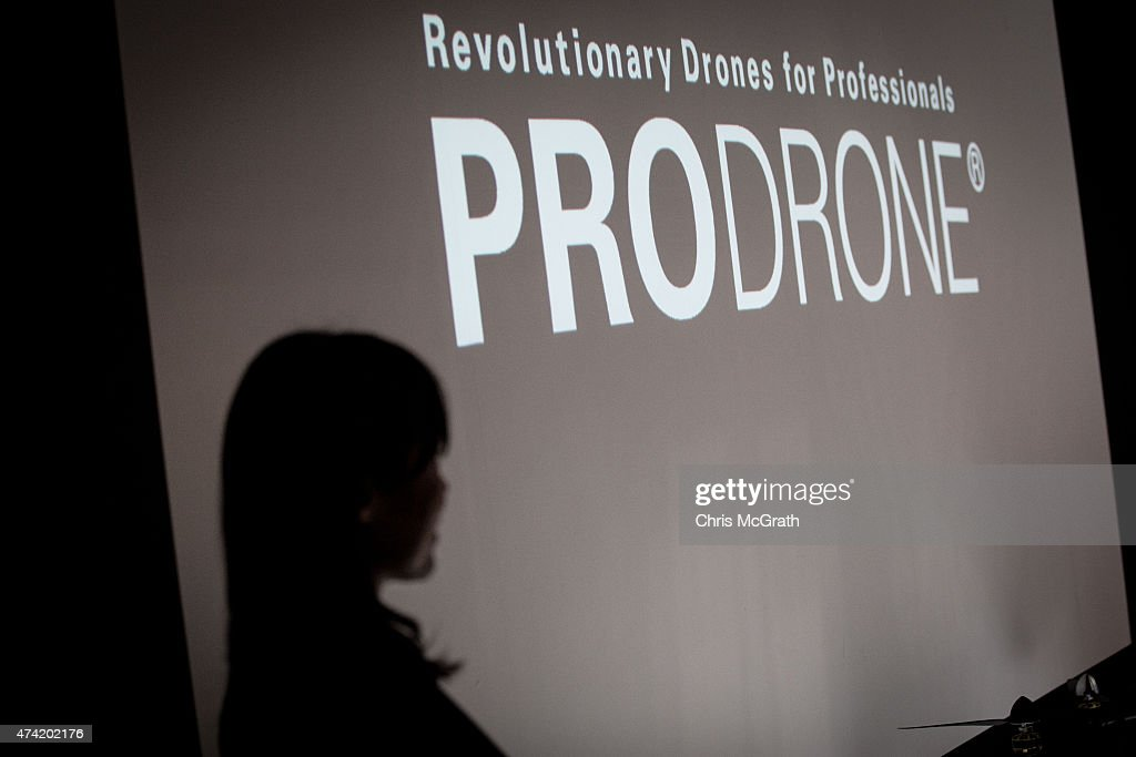 A woman gives a product presentation at the Prodrone booth during the International Drone Expo 2015 at Makuhari Messe on May 21, 2015 in Chiba, Japan.