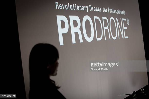 A woman gives a product presentation at the Prodrone booth during the International Drone Expo 2015 at Makuhari Messe on May 21 2015 in Chiba Japan