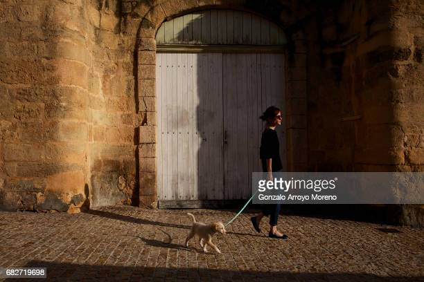 A woman gives a walk to her dog the day before of the Ironman 703 Pays d'Aix on May 13 2017 in AixenProvence France