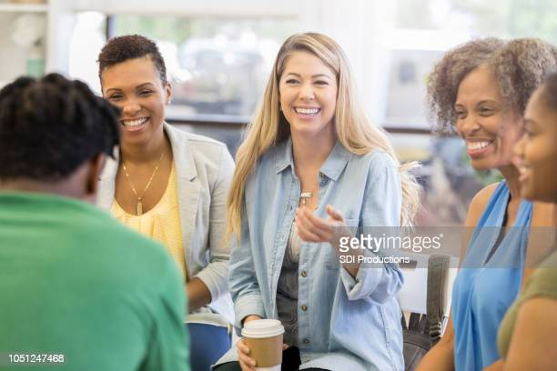 woman gives humorous advice in support group - group therapy stock pictures, royalty-free photos & images